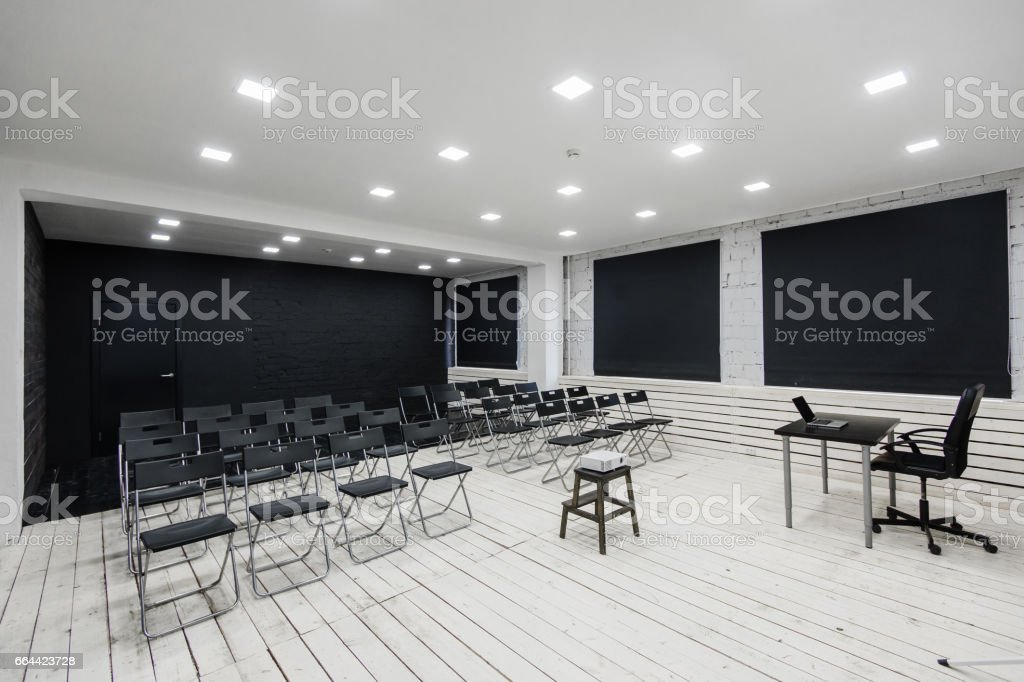 Empty classroom with chairs and desks stock photo