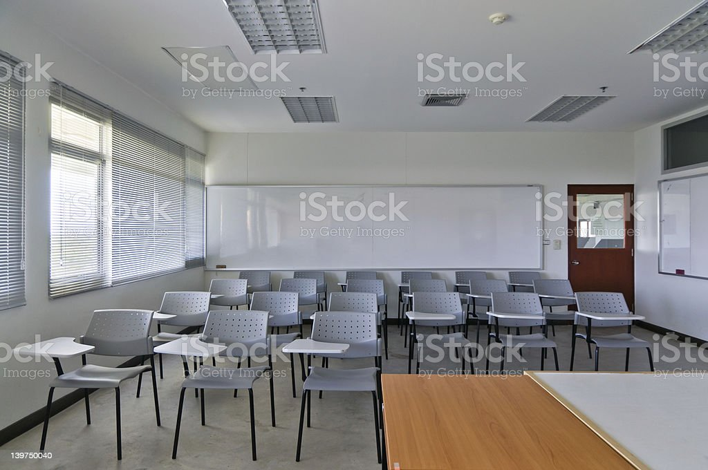 Empty classroom with chairs and white board stock photo