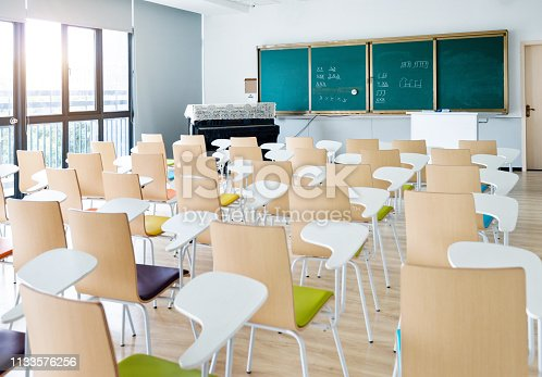 istock Empty classroom with desks and chairs for music lessons 1133576256