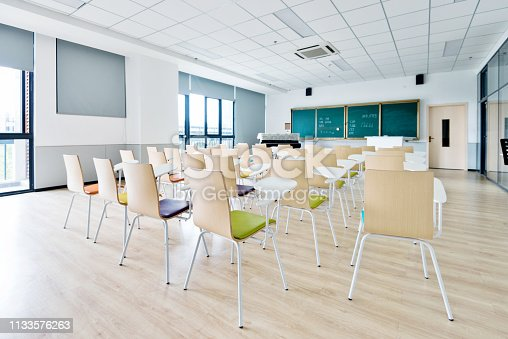 istock Empty classroom with desks and chairs for music lessons 1133576263