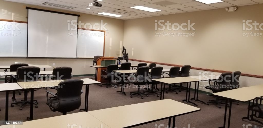 Empty Classroom With Tables Chairs Podiums Projector And