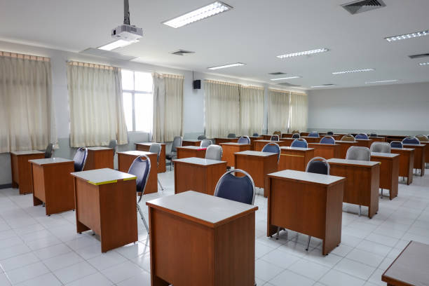 Empty classroom with vintage tone wooden chairs. Classroom arrangement in social distancing concept to prevent COVID-19 pandemic. Back to school concept. stock photo