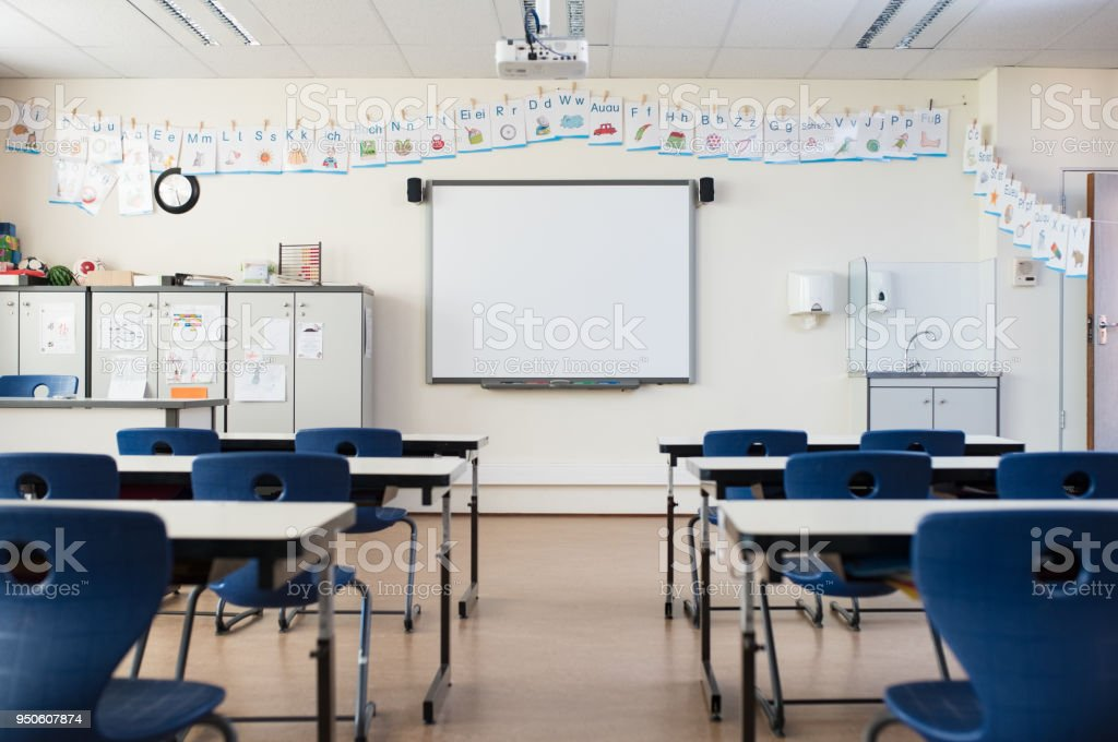 Empty classroom with whiteboard stock photo