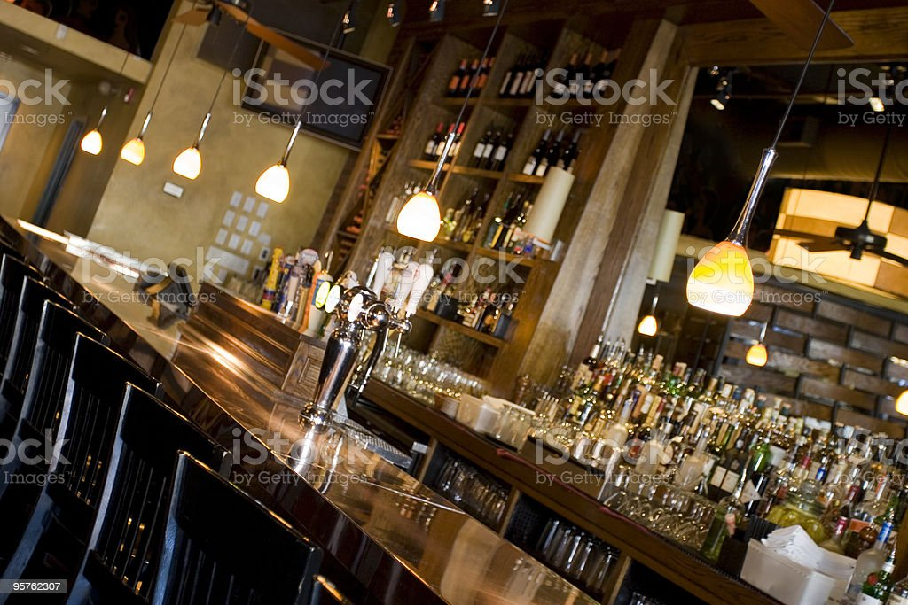 Empty Classy Bar with Alcohol Bottles, Barstools and Mirror stock photo