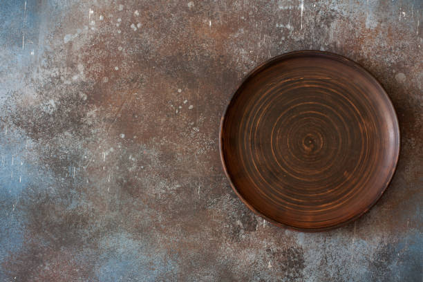 Empty clay  plate on stone  background stock photo