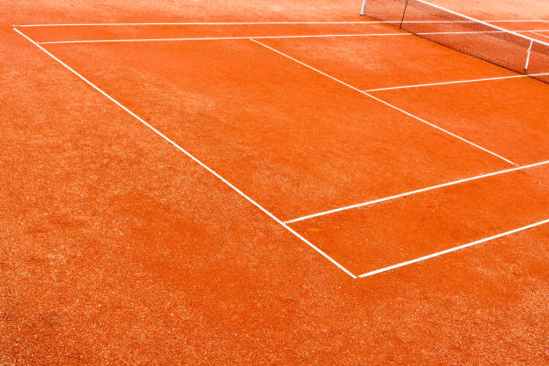 Empty clay tennis court stock photo