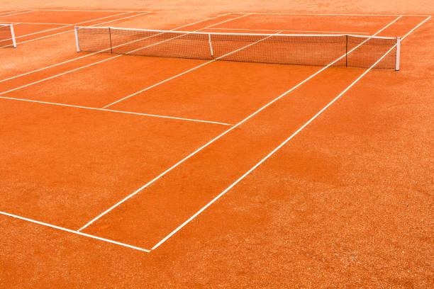 Empty clay tennis court stock photo