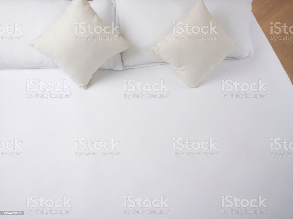 Empty Clean Bed with Pillows stock photo