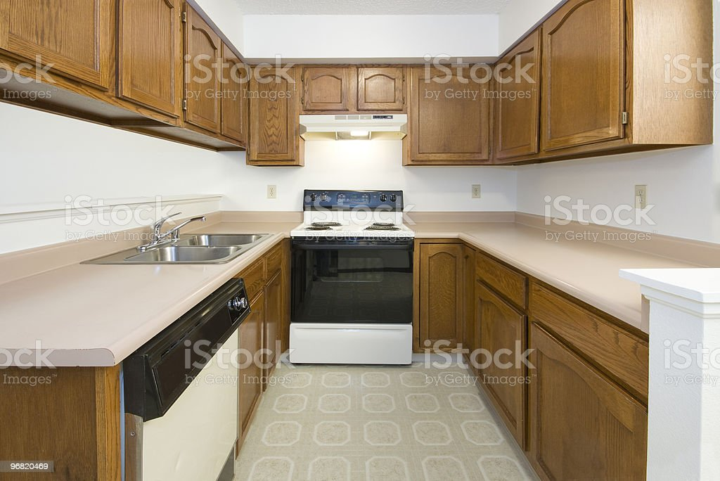 Empty clean older style kitchen area stock photo