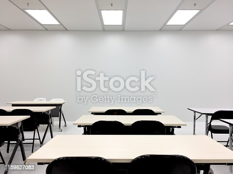 Empty ,clean ,room,chairs, tables,training,meeting