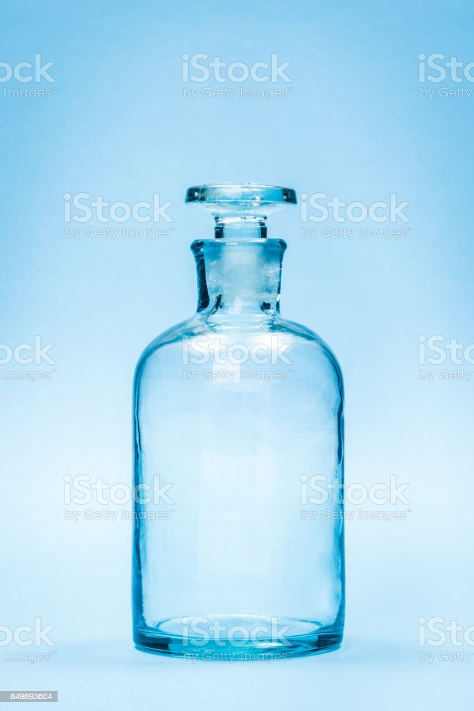 Empty clear reagent bottle with glass stopper stock photo