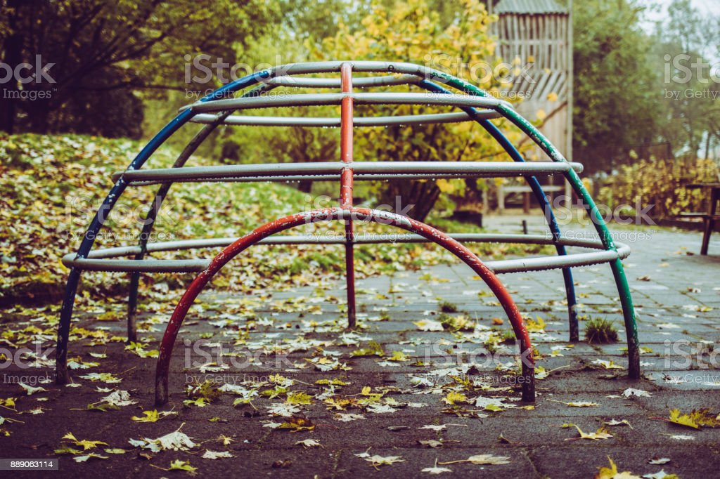 Empty climbing frame at playground stock photo