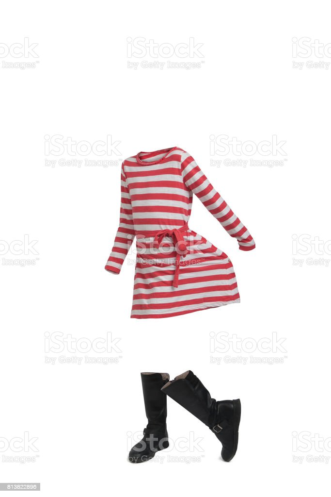 Empty clothes. Cute girl waring a striped dress and boots. stock photo