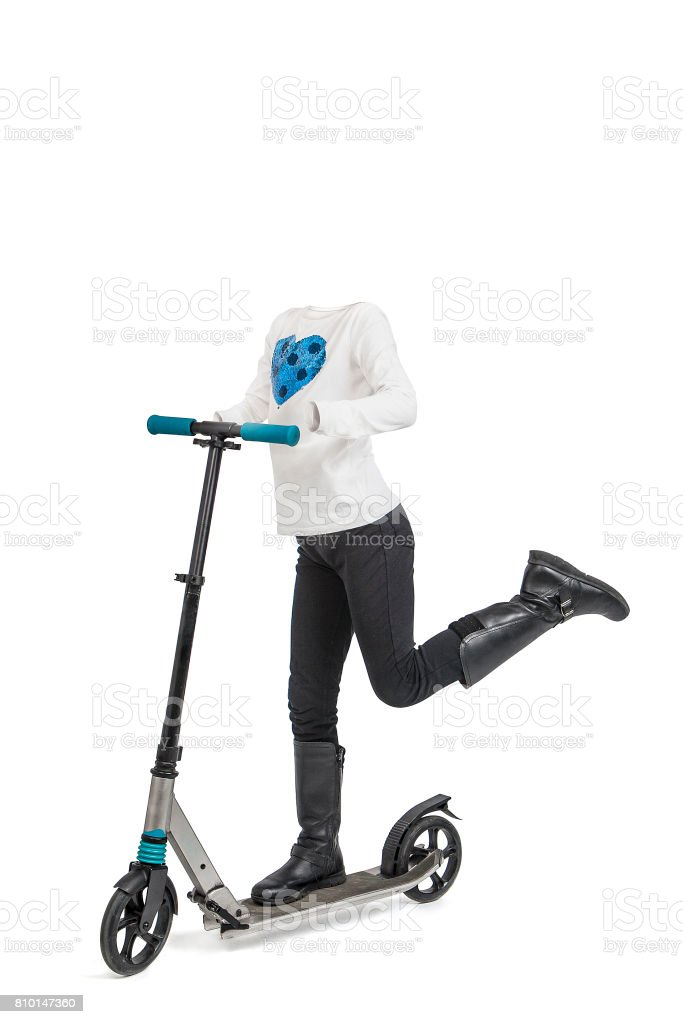 Empty clothes. Little girl with withe shirt and black pants in a scooter. stock photo