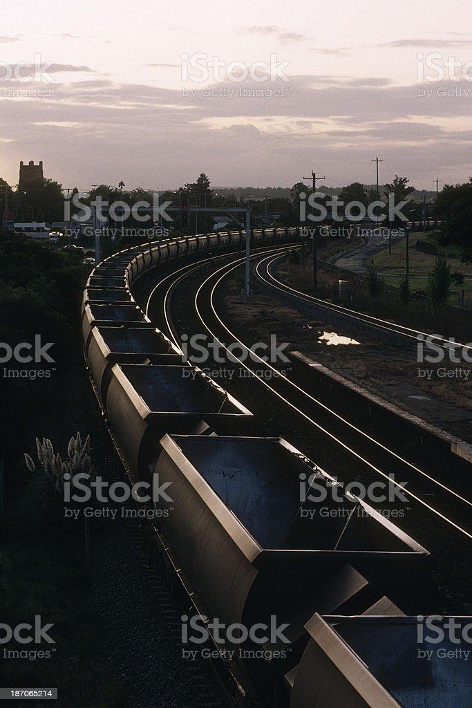 Empty coal train at sunset royalty-free stock photo