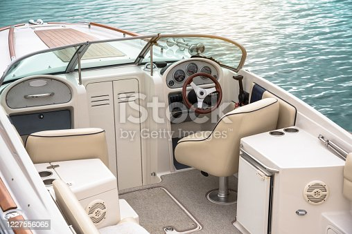 istock Empty cockpit of a moored speedboat 1227556065