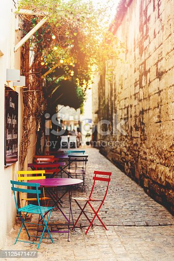 Empty coffee terrace with tables and chairs on South of France