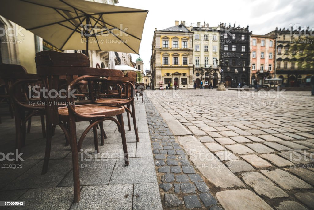 Empty coffee terrace with tables and chairs stock photo