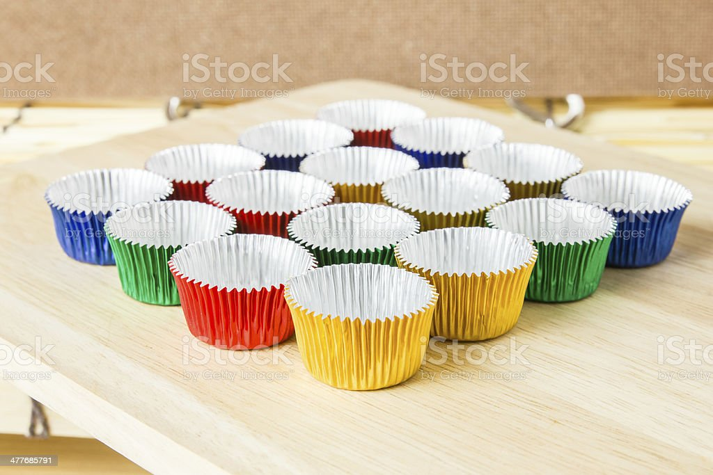 Empty colorful foil cup for make bakery royalty-free stock photo