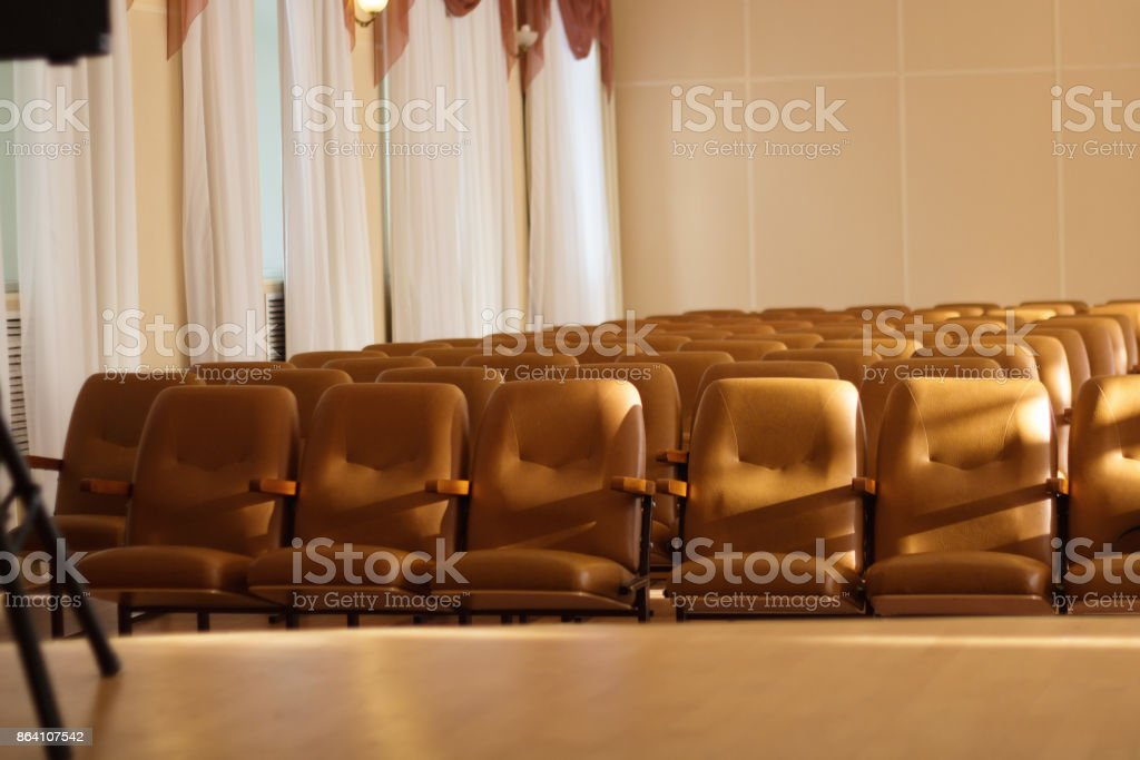 Empty comfortable brown seats in a hall . royalty-free stock photo