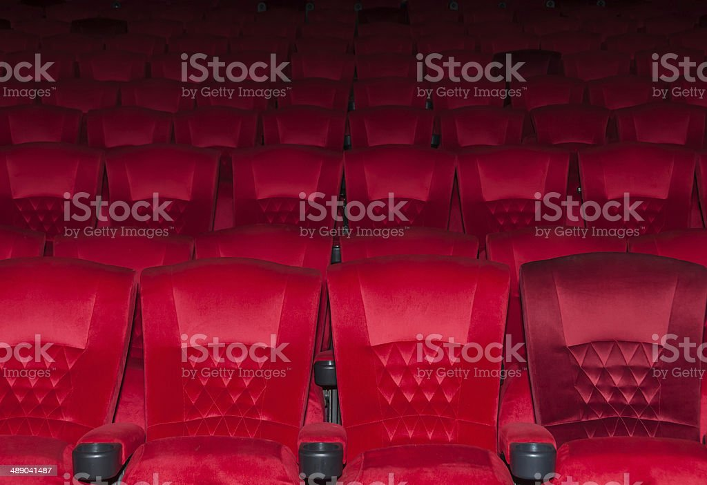 Empty comfortable red seats in thearter stock photo