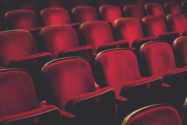 Empty comfortable red seats with numbers in cinema stock photo
