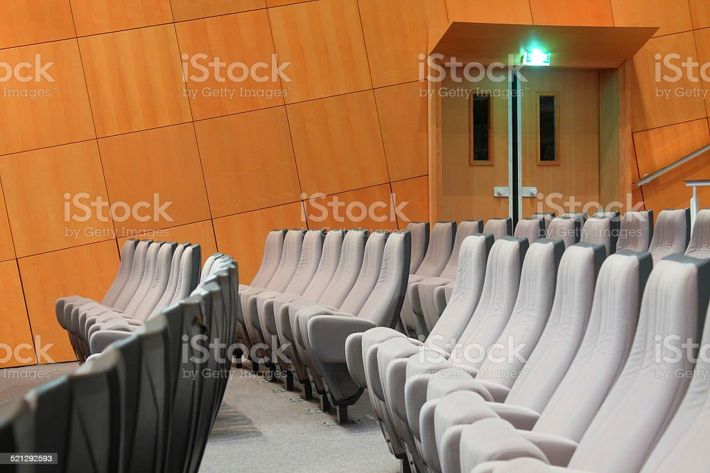 Empty common theater seating stock photo : auditorium doors - pezcame.com