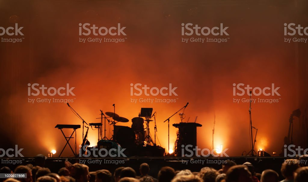 empty concert stage on music festival, instruments silhouettes stock photo