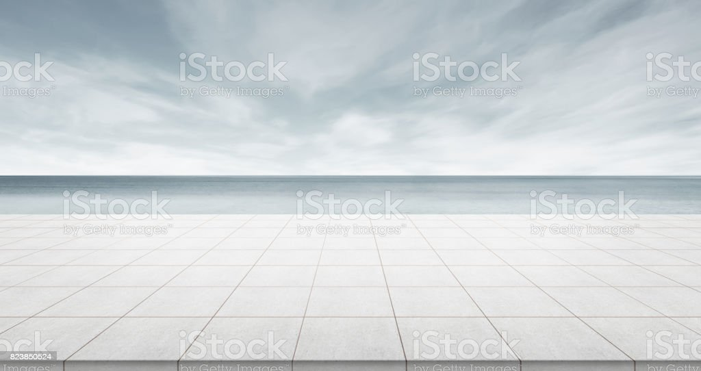 Empty concrete floor top with panoramic ocean view of morning dark sky stock photo
