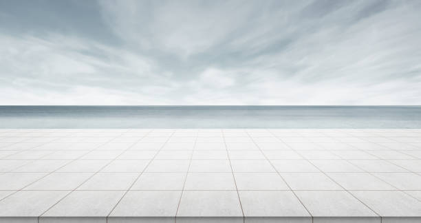 Empty concrete floor top with panoramic ocean view of morning dark sky Business concept - Empty concrete floor top with panoramic ocean view of morning dark sky for display or montage product showroom stock pictures, royalty-free photos & images