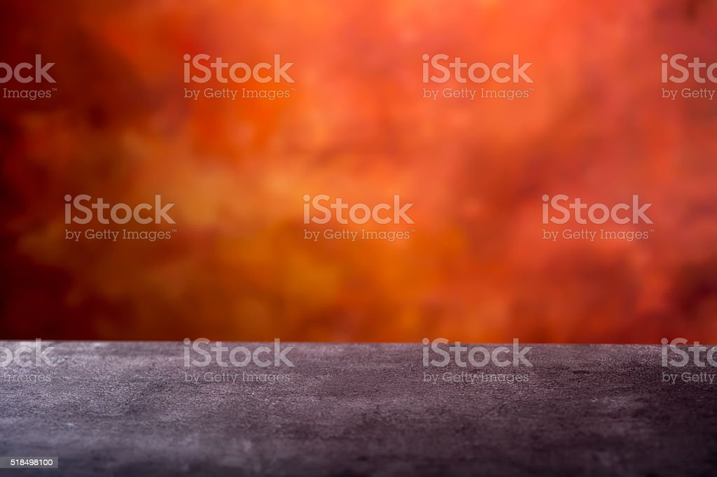 Empty concrete table and abstract batik orange - red background stock photo