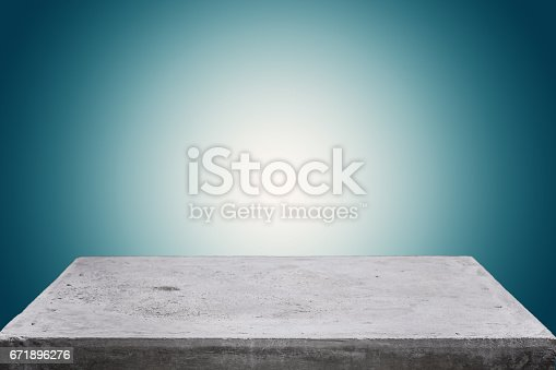 istock Empty concrete table top on concrete gradient background,  Template mock up for display of your product. 671896276