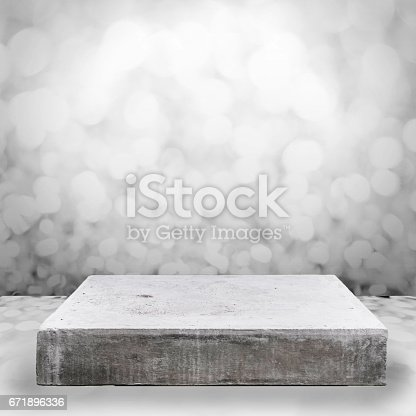 671896388istockphoto Empty concrete table top on concrete gradient background,  Template mock up for display of your product. 671896336