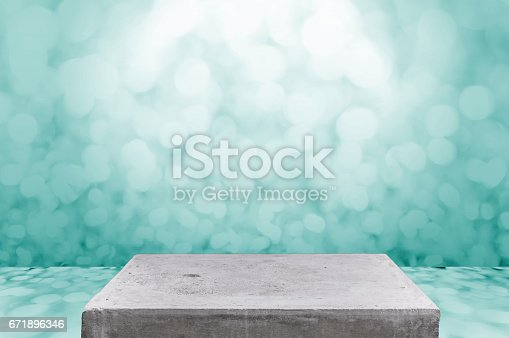 671896388istockphoto Empty concrete table top on concrete gradient background,  Template mock up for display of your product. 671896346