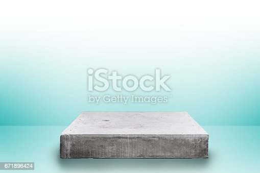 671896388istockphoto Empty concrete table top on concrete gradient background,  Template mock up for display of your product. 671896424
