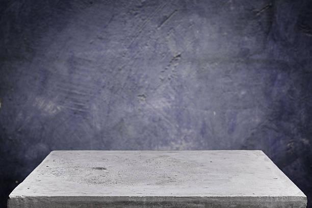 Empty concrete table top on grunge concrete background stock photo