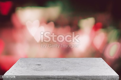 671896388istockphoto Empty concrete table top on vintage bokeh background 517377076