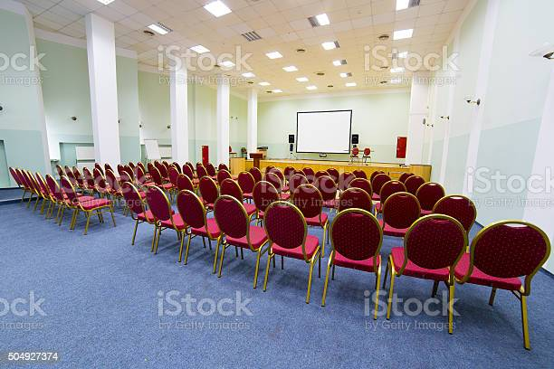 Empty conference hall picture id504927374?b=1&k=6&m=504927374&s=612x612&h=nlrbcmanomotwi7khzn bvtwez4bjwjxrm toax 58o=