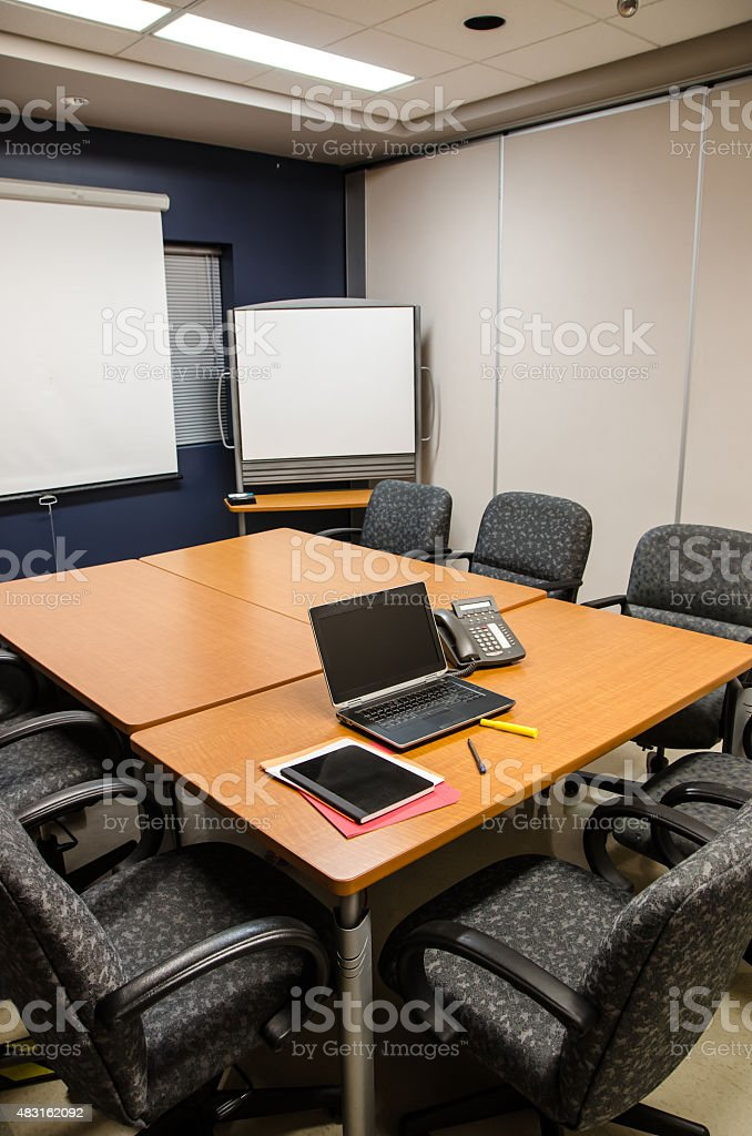 Empty Office Conference room with laptop phone notebook