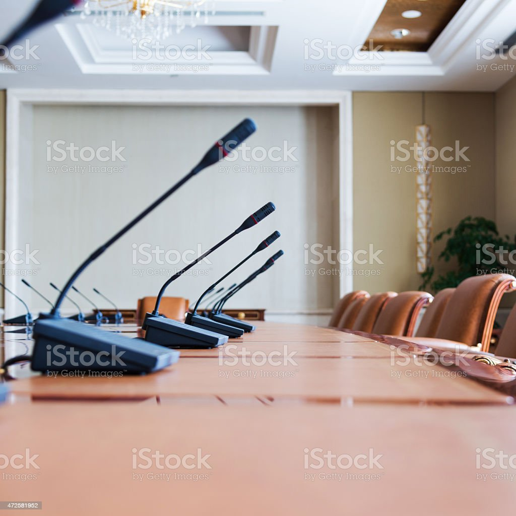 conference table with group of microphones before conference.