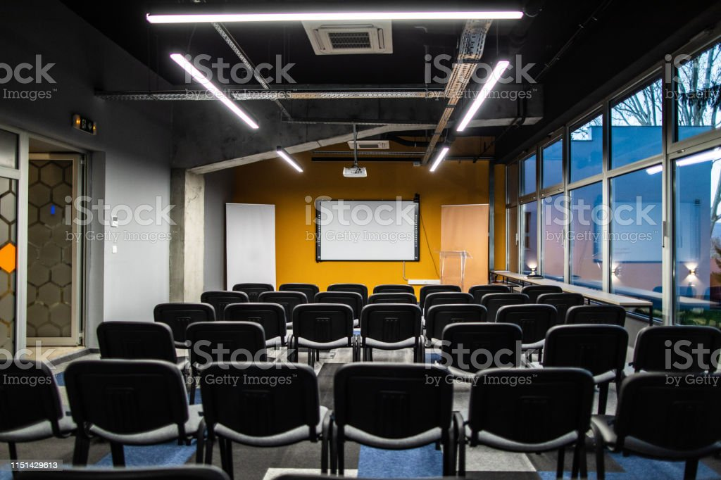 Big empty conference room with a lot of chair in a row, projection...