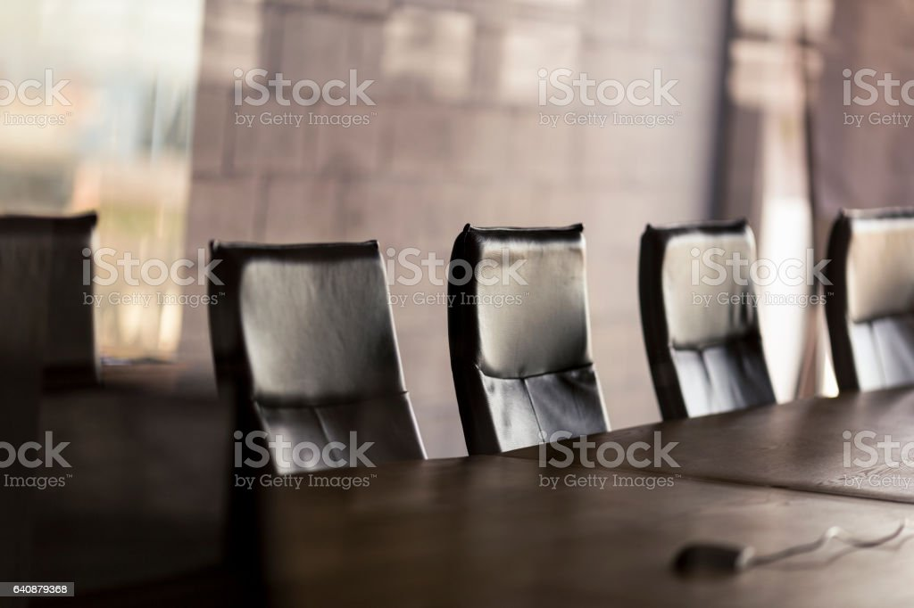 Empty conference table in board room at office stock photo