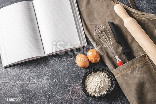 istock Empty cookbook and kitchen equipment 1211567022
