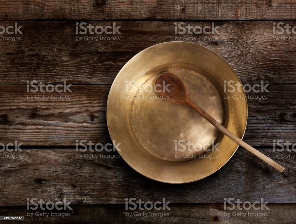 Empty copper tray, wooden spoon on a  table stock photo