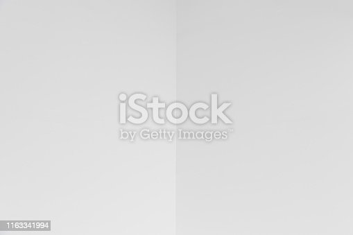 istock empty corner of white wall or ceiling with copyspace. 1163341994