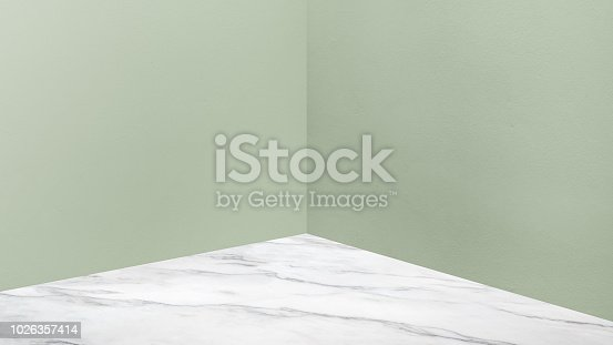 istock Empty corner pale green concrete wall and  white marble floor perspective room,Modern style room,Mock up for display of product,business presentation. 1026357414