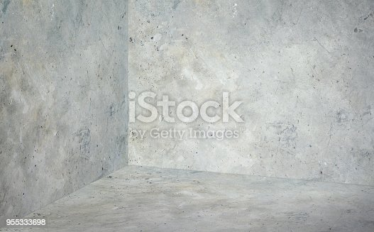 Empty corner room with grey concrete wall and floor background,Mock up studio room for display or montage of product for advertising on media,Business presentation.