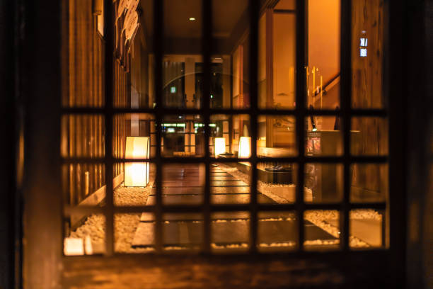 Empty corridor hall garden in Gion district at night with illuminated golden yellow path stock photo