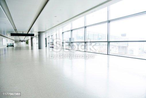 Empty corridor in airport building.