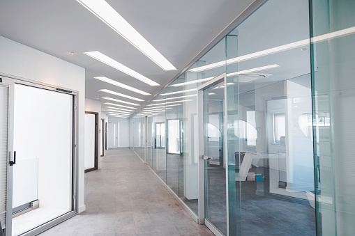 Background of empty corridor in modern shopping mall, office or hospital